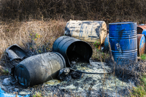 Barrels of toxic chemicals in nature, pollution of the environment