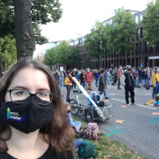 Girl with mask on the street during demonstration